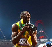 Usain Bolt grabs Jimmy Wixtröm's DSLR and start snapping away